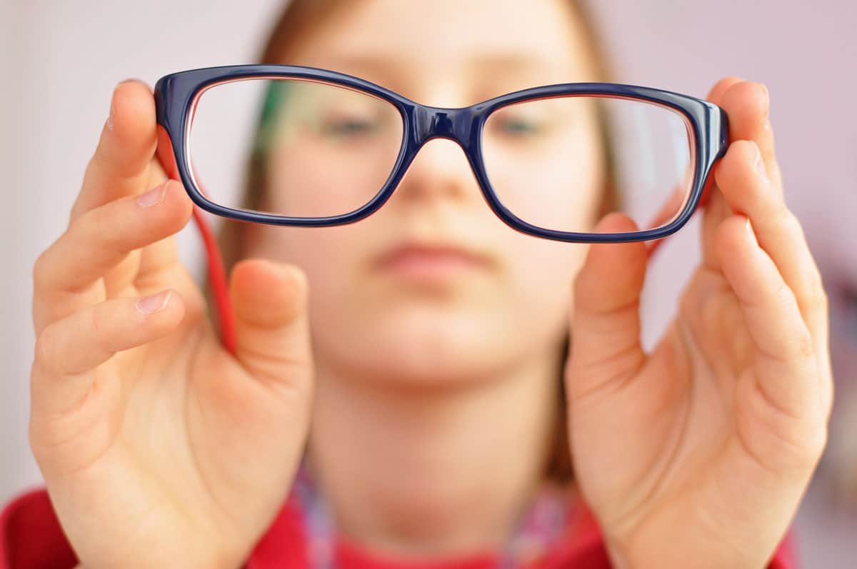 Visual Impairment - person holds up glasses