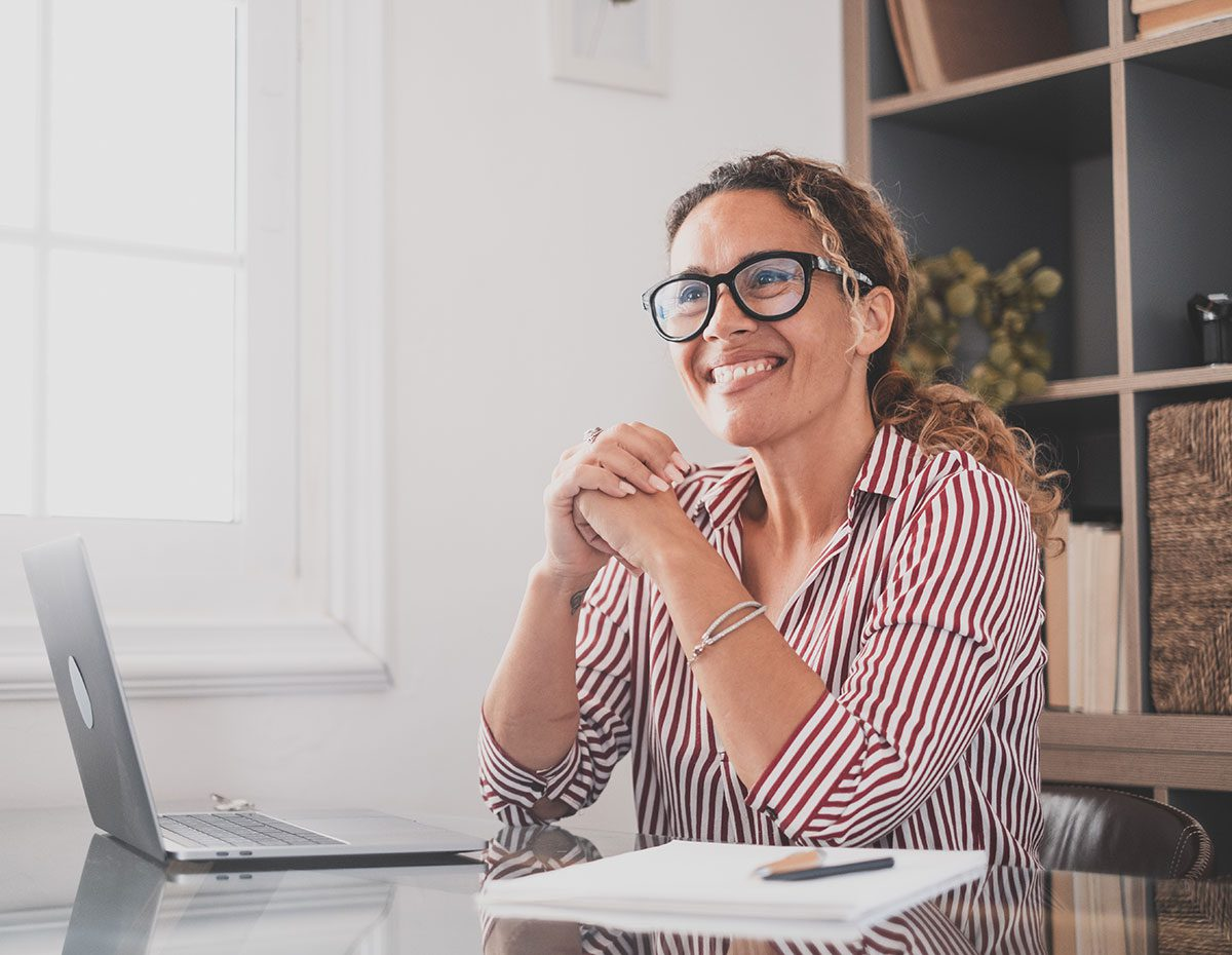 Smiling woman using website