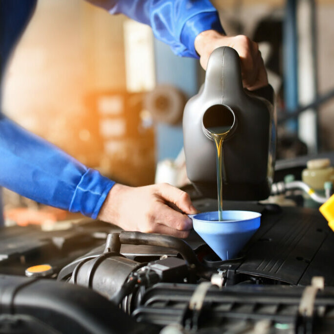 Mechanic filling car with oil to indicate the importance of e-commerce website care