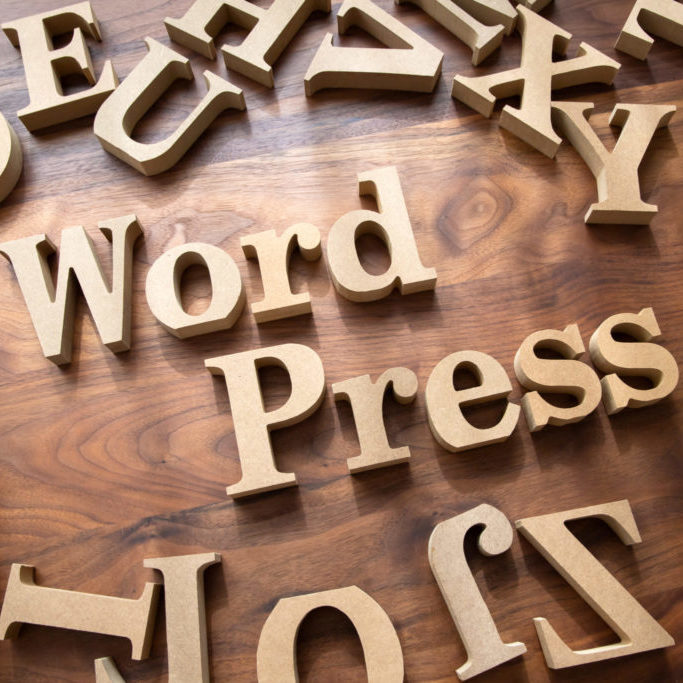 Letter blocks arranged to say WordPress - image for why choose wordpress