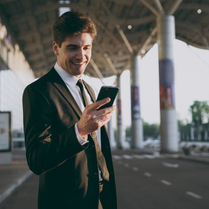 Man on Smartphone at Airport